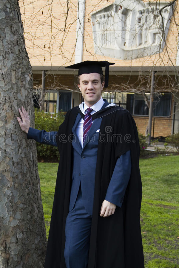 A Young Man In A Graduation Gown. Stock Photo - Image of board ...