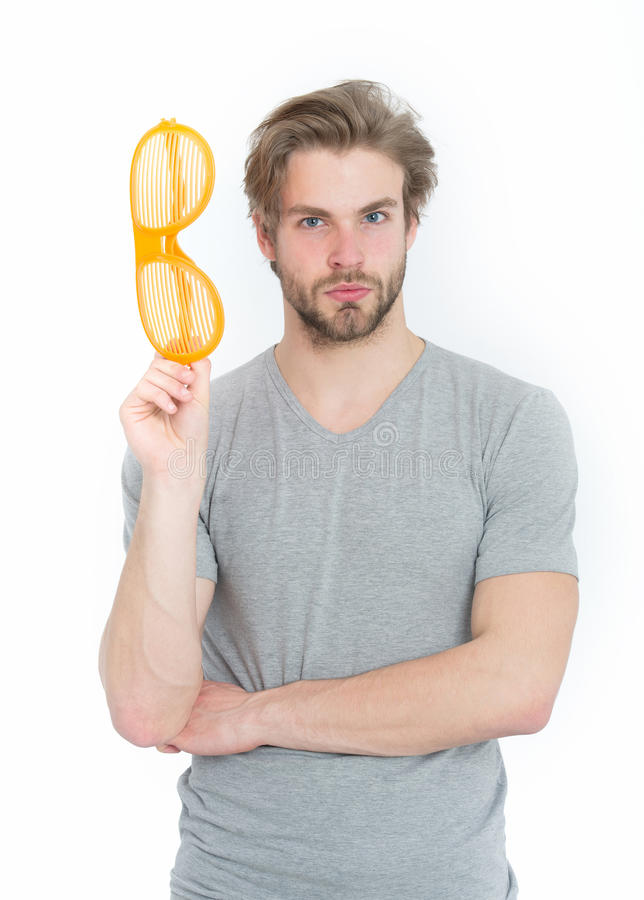 Young man in grey shirt with funny orange big glasses royalty free stock image