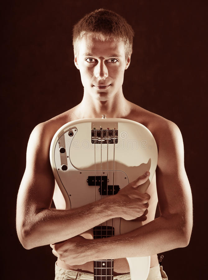Young Man With A Guitar Stock Photo
