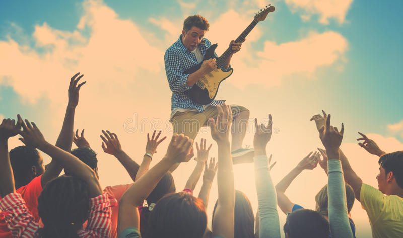 Young Man Guitar Performing Concert Concept.  royalty free stock images