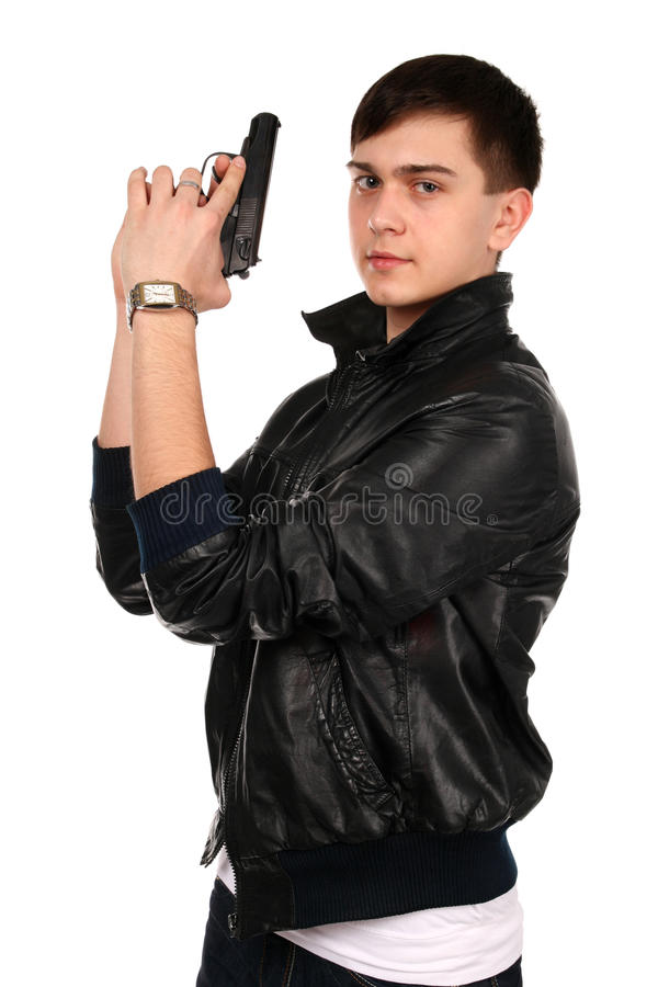 Young Man With Gun. Royalty Free Stock Photography