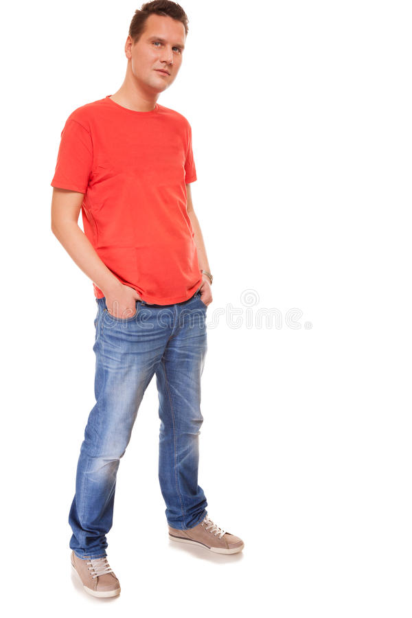 Young man guy red t shirt jaens with hands in pockets for Jeans t shirt style