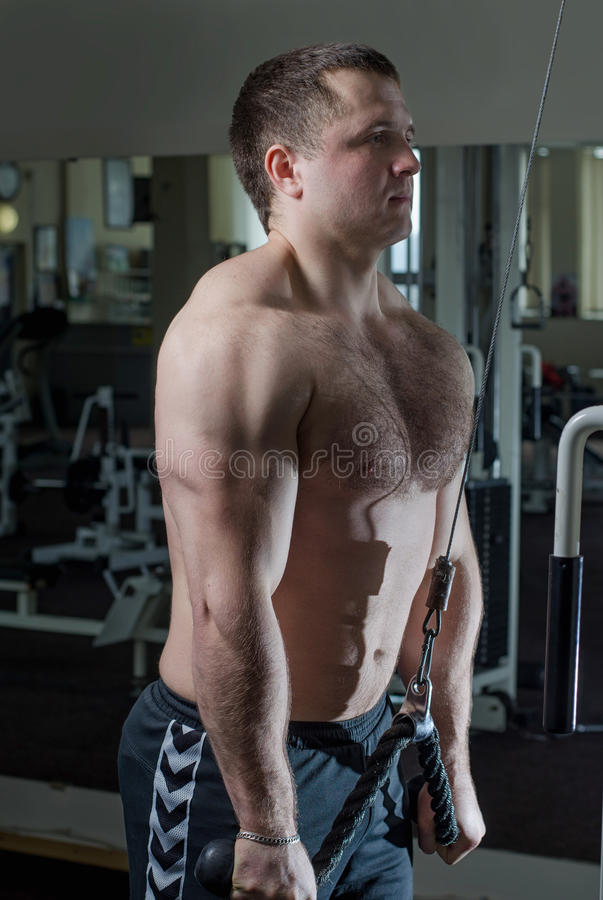 Young man at the gym stock photo