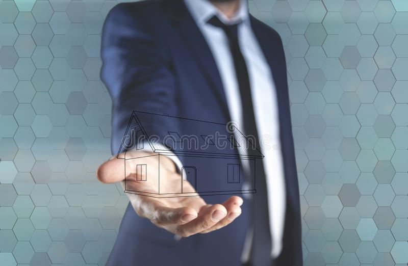 Young man hand house model in screen stock image