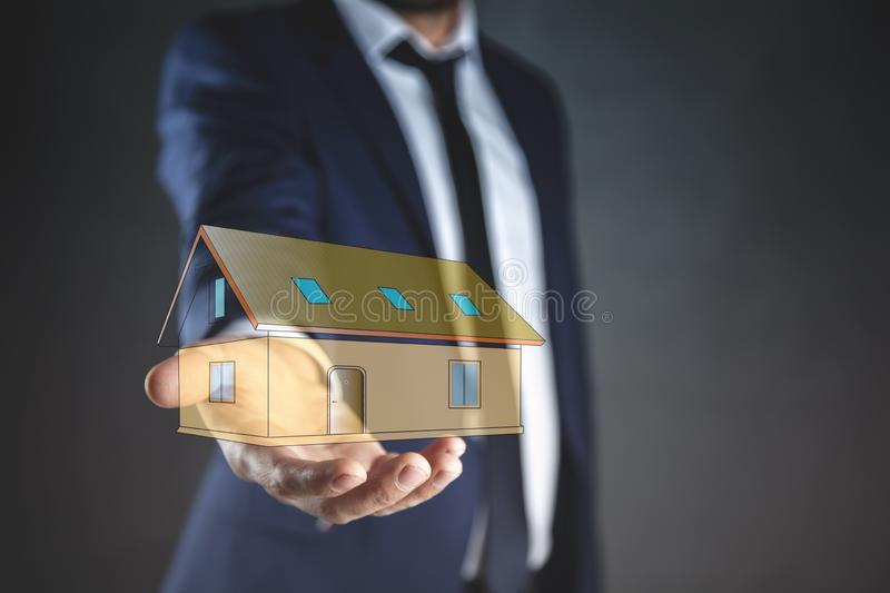 Young man hand house model in screen stock photography