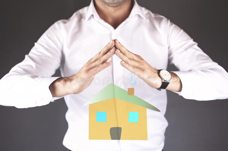 Young man hand house model in screen stock images