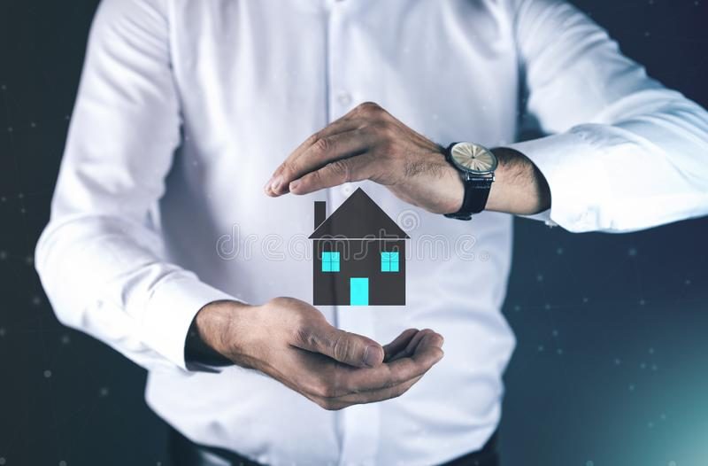 Young man hand house model in screen. Man hand house model in screen stock images