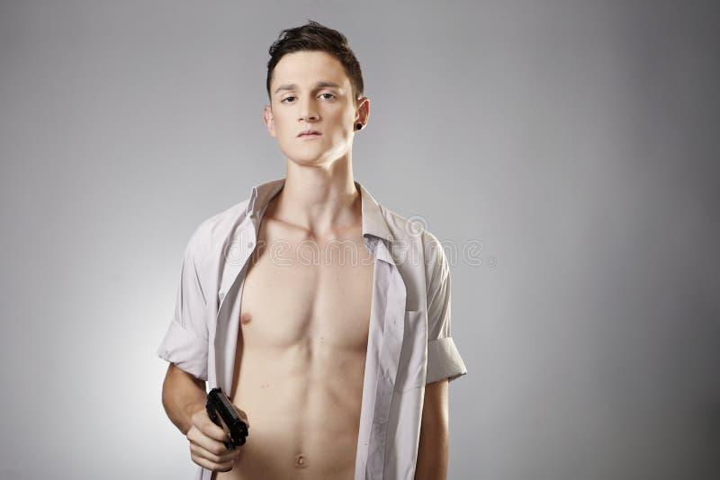 Young man with handgun stock photos