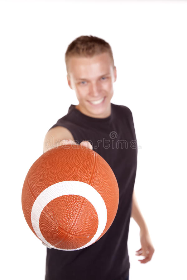 Download Young man handing football stock photo. Image of hand - 16254858
