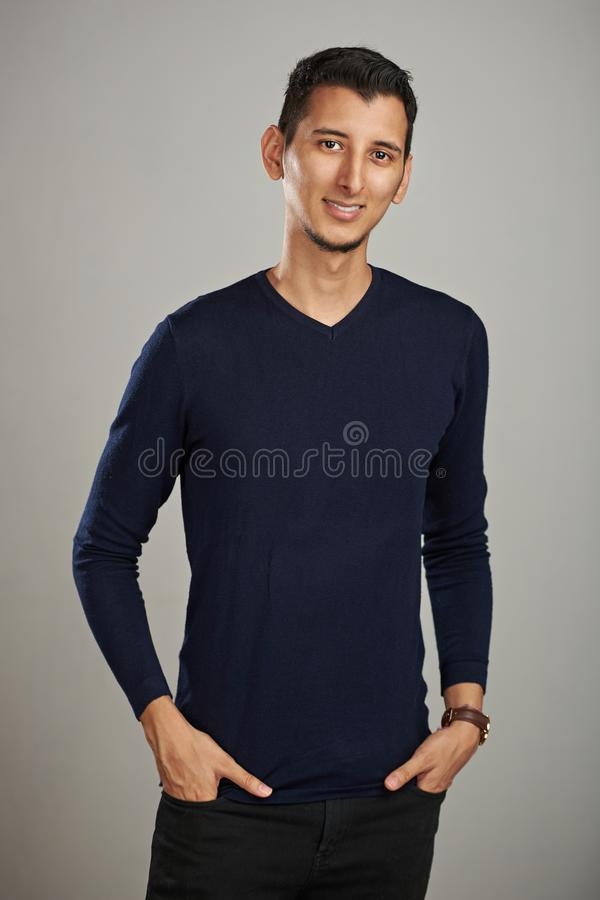 Young man with hands in jeans pocket stock photography