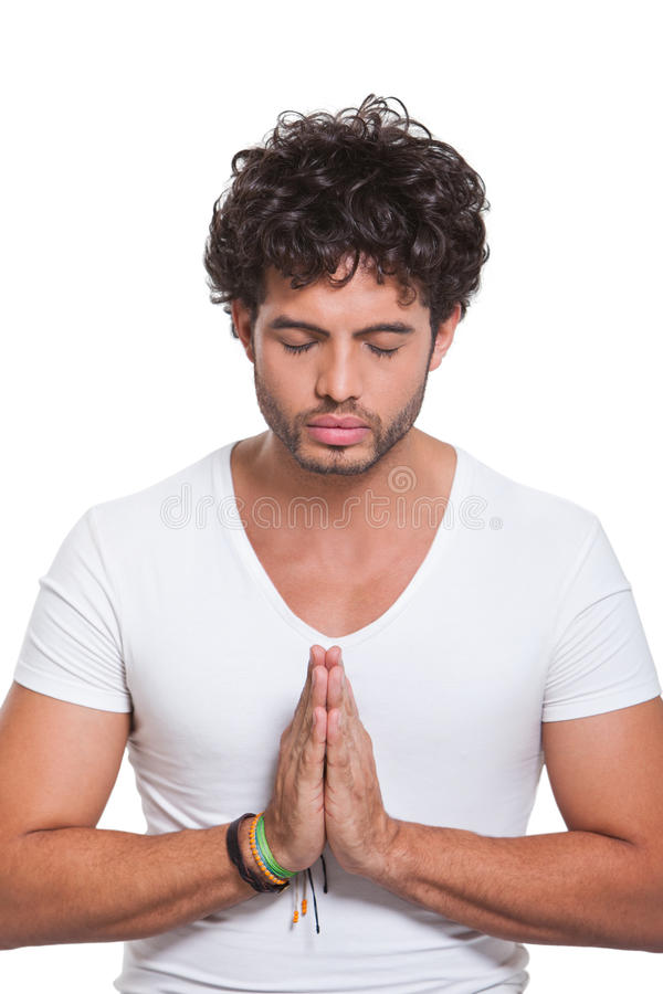 Young Man With Hands In Prayer Royalty Free Stock Photos