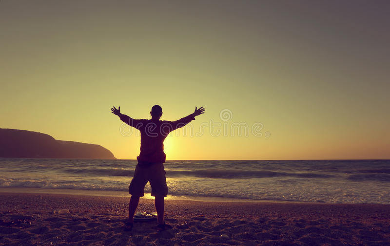 Download Young Man Hands Up On A Beach At Sunset Stock Photo - Image of inspiration, male: 40259592