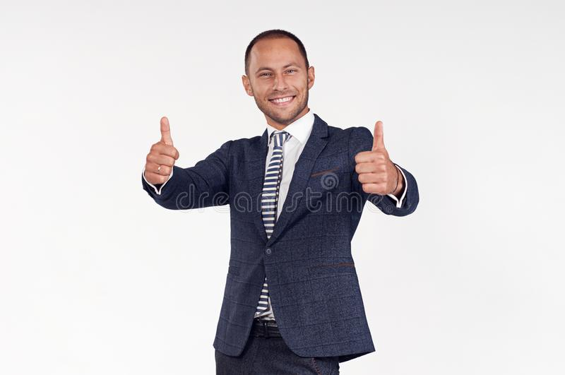 A young man is happy to lift his arms up. The guy is surprised. stock images