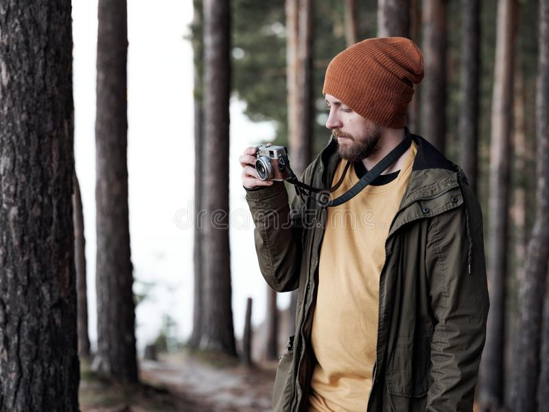 Man with camera taking photo in slender forest royalty free stock photos