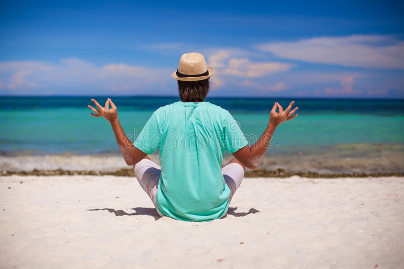 Download Young Man In Hat Sitting In The Lotus Position On Royalty Free Stock Photo - Image: 32188065
