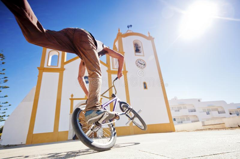 Young man have fun doing tricks with freestlye stock image