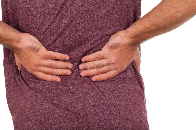 Young man having backpain. Close up picture of a young man having a serious back pain royalty free stock images