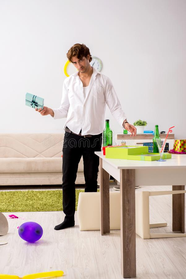 The young man having hangover after party. Young man having hangover after party stock image