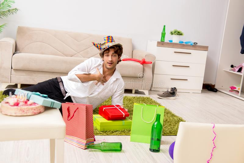 The young man having hangover after party. Young man having hangover after party royalty free stock photo