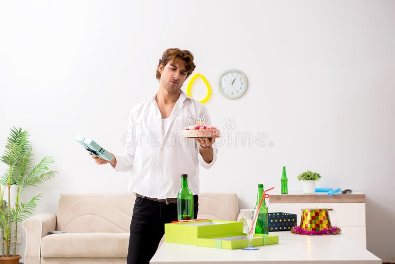 The young man having hangover after party. Young man having hangover after party royalty free stock photography