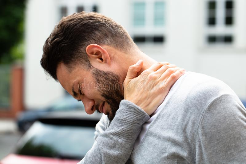 Man Suffering From Neck Pain stock image