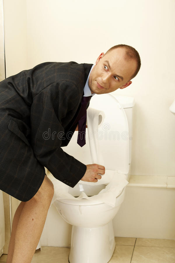 Young man having toilet issues. YÄŸung man having problematic toilet issues stock photography