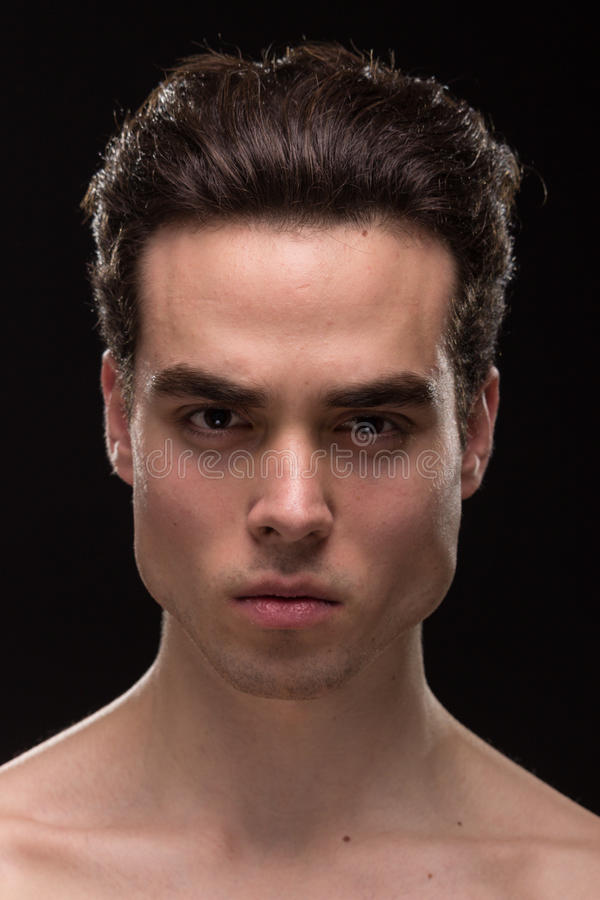 Young man head face closeup jawline. Young adult man model head face shoulders shirtless closeup jawline royalty free stock image