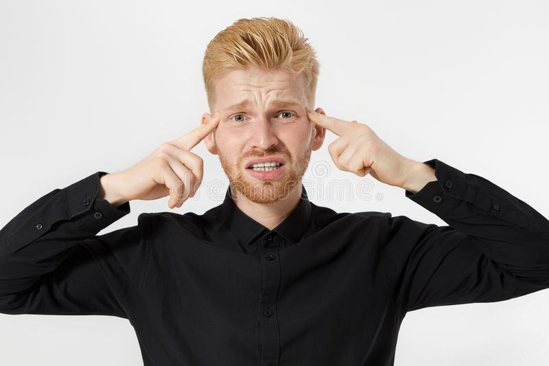 Young man headache. Redheaded guy with red beard in thinking process isolated. Close up of male face. Mental and mind working. stock image