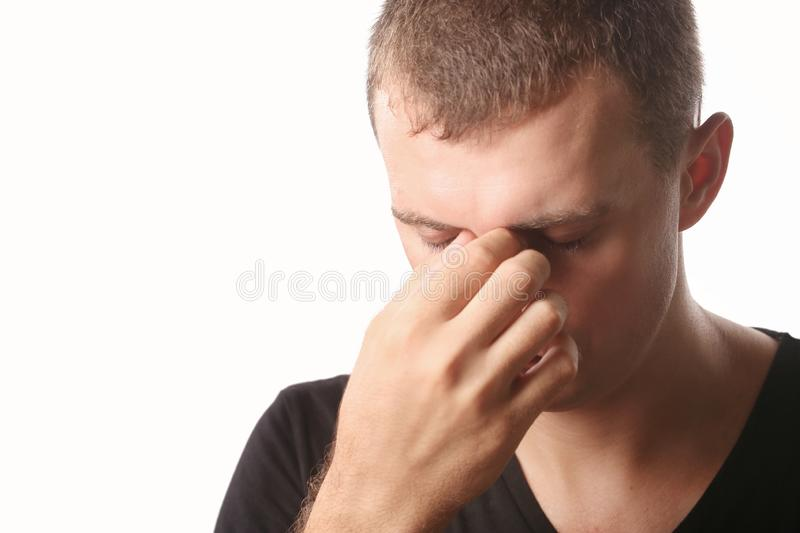 Young man with headache or sinus pain royalty free stock photo