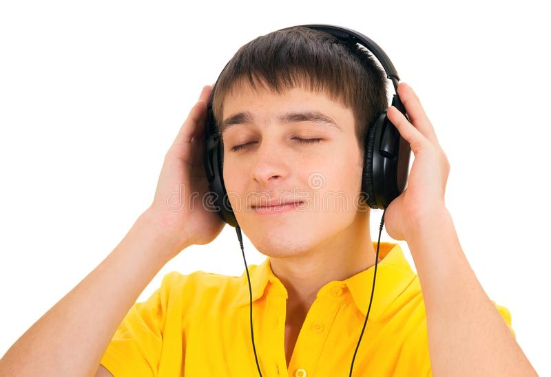 Young Man in Headphones. Listen the music Isolated on the White Background royalty free stock image