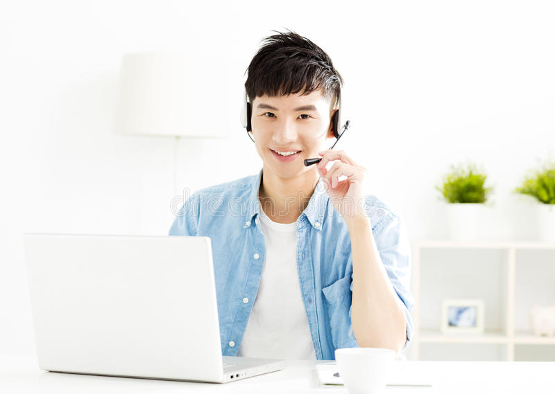 Young man with headset and laptop royalty free stock photo