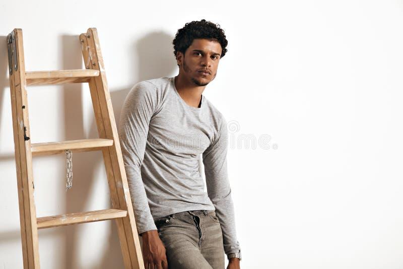Young man in heather grey long sleeve shirt stock photos