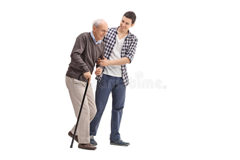 Young man helping a senior gentleman stock images