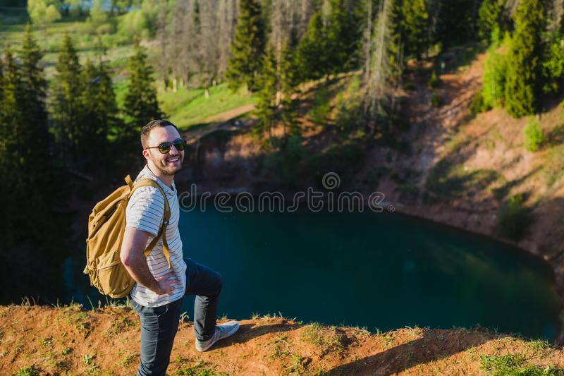 Young man hiking smiling happy portrait. Male hiker walking in forest royalty free stock image