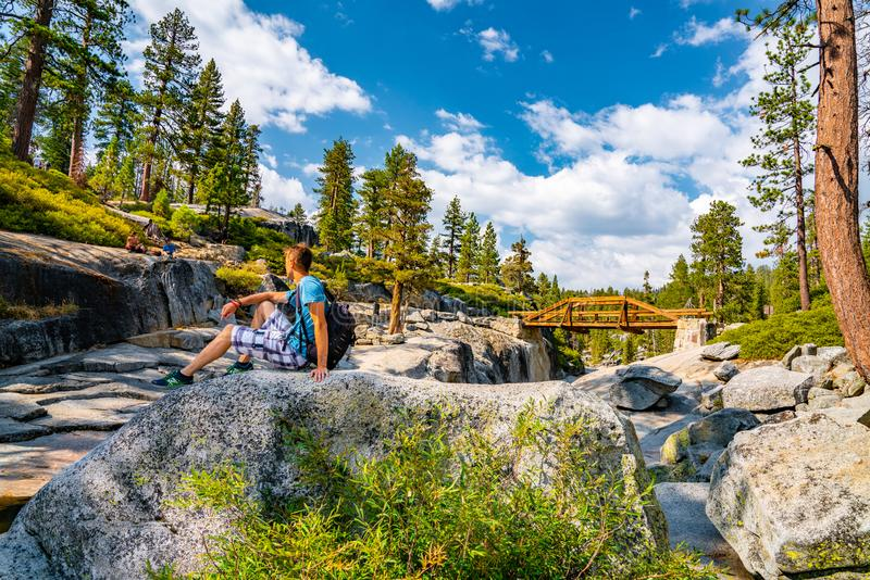 Young man hiking in the Yosemite National park. Exploring the valley stock photography