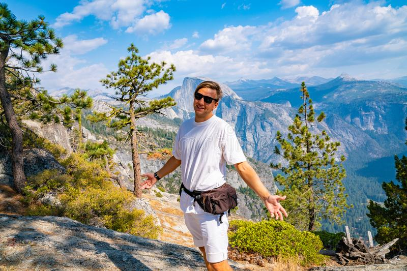 Young man hiking in the Yosemite National park. Exploring the valley stock photos