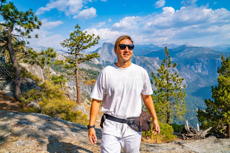 Young man hiking in the Yosemite National park. Exploring the valley royalty free stock photo