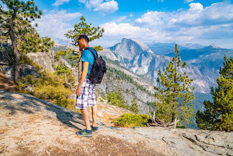 Young man hiking in the Yosemite National park. Exploring the valley stock images