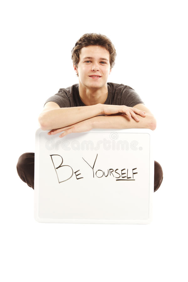 Young man with hip style holding sign. That says be yourself stock image