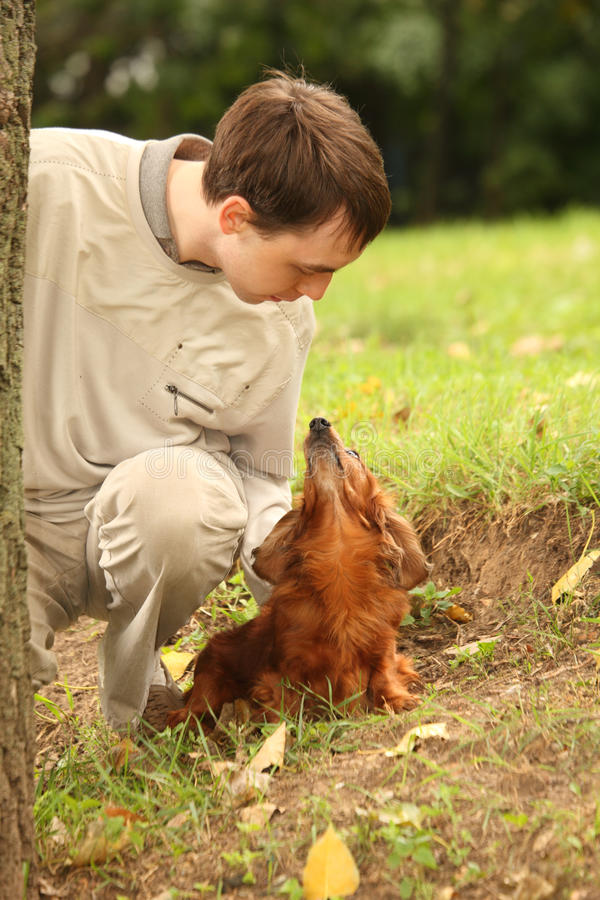 Download Young Man And His Dachshund Looks On Each Other Stock Image - Image of best, friend: 11411243
