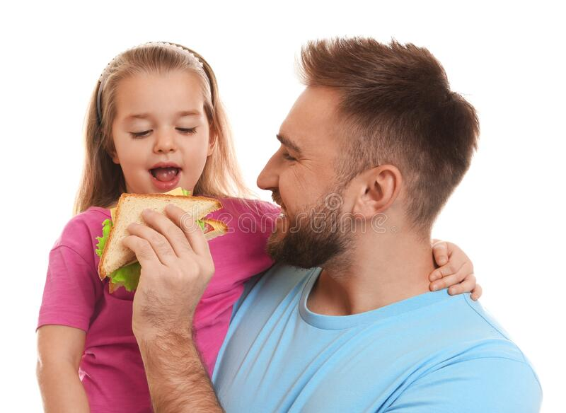 Young man and his daughter with sandwich on background royalty free stock image