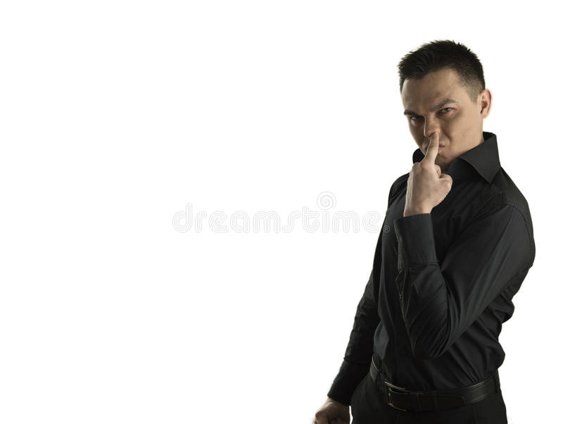 Young man with his finger in his nose royalty free stock image