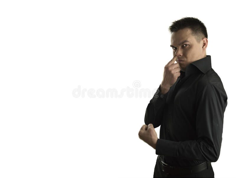 Young man with his finger in his nose stock image