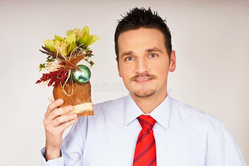 Young man hold Christmas gift stock image