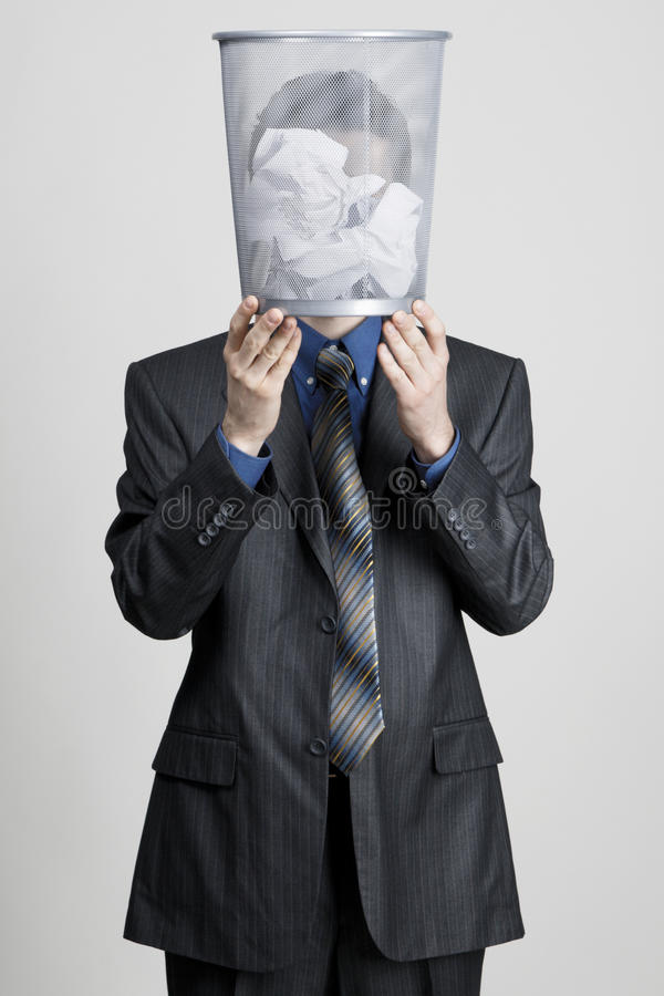 Download Young Man Holdin A Trash Bin Against His Head Stock Image - Image: 14083379