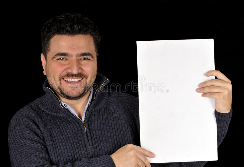 Young man holding blank sign. royalty free stock photo