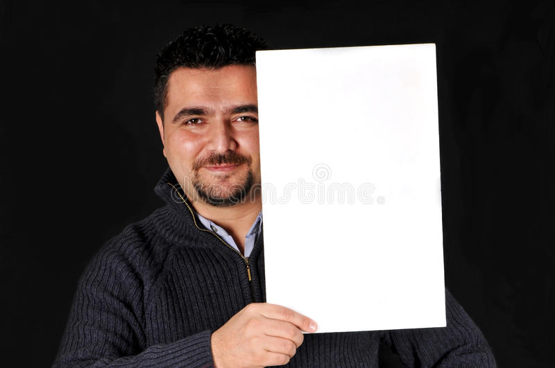 Young man holding blank sign. royalty free stock photography