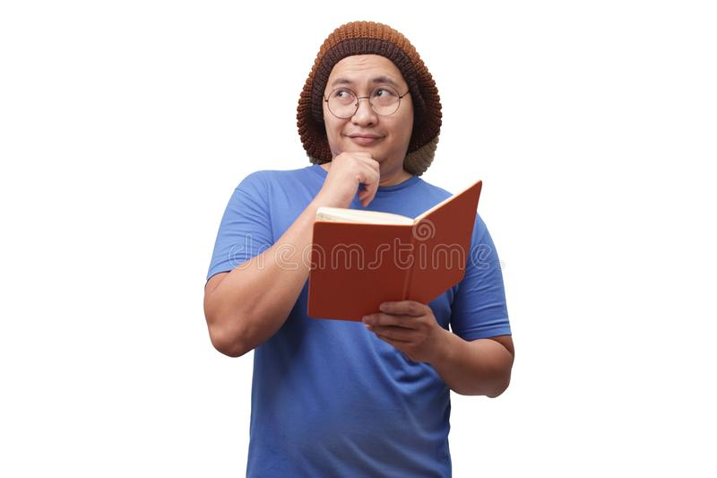 Young Man Holding Book, Thinking Expression royalty free stock image