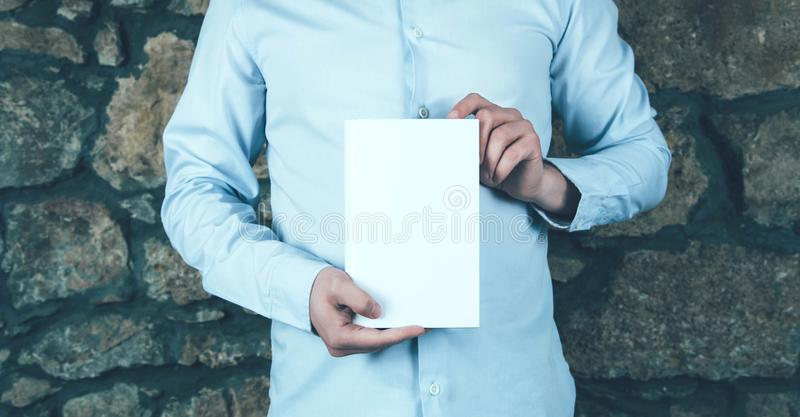 Young man holding a book. stock images