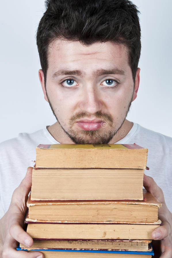 Young Man Holding Books Stock Photography